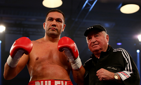 HAMBURG, GERMANY - DECEMBER 05: Kubrat Pulev (L) of Bulgaria celebrate victory over Maurice Harris of USA after their heavyweight fight at Inselparkhalle on December 5, 2015 in Hamburg, Germany. (Photo by Martin Rose/Bongarts/Getty Images)