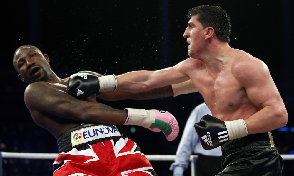Marco Huck from Germany, right, lands a punch to Britain's Ola Afolabi during their WBO cruiserweight championship title bout in Berlin, Germany, Saturday, June 8, 2013. Huck retained his WBO belt by defeating Afolabi by majority decision on Saturday. (AP Photo/Michael Sohn) ORG XMIT: SOB101