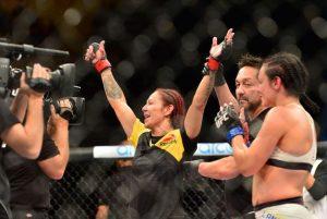 Sep 24, 2016; Brasilia, Brazil; Cris Cyborg (red gloves) celebrates defeating Lina Lansberg (blue gloves) during UFC Fight Night at Nilson Nelson Gymnasium. Mandatory Credit: Jason Silva-USA TODAY Sports