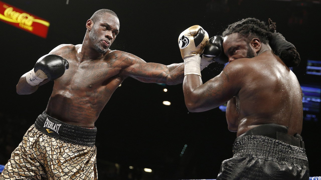 Deontay Wilder hits Bermane Stiverne during their WBC heavyweight title boxing bout Saturday, Jan. 17, 2015, in Las Vegas. (AP Photo/John Locher)