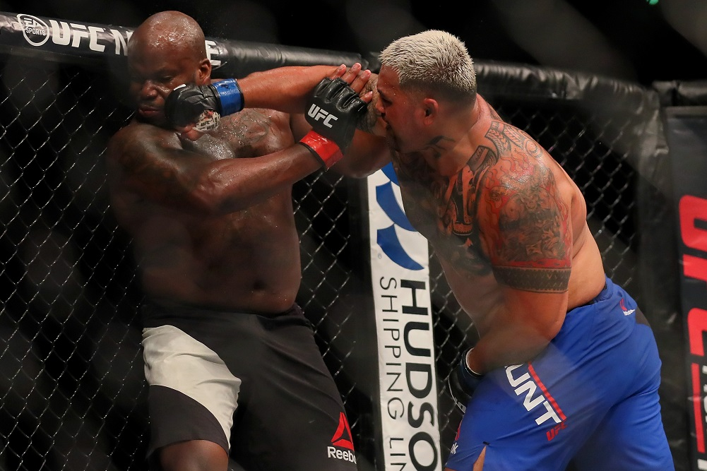 Jun 10, 2017; Auckland, NZ; Derrick Lewis (red gloves) fights against Mark Hunt (blue gloves) during UFC Fight Night at Spark Arena. Mandatory Credit: Simon Watts-USA TODAY Sports
