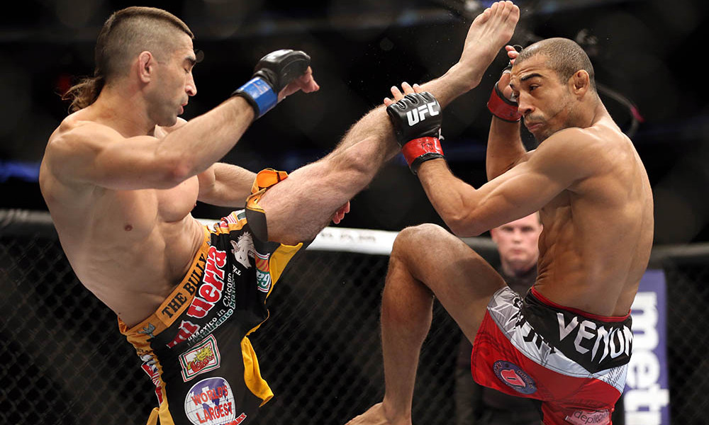 Feb 1, 2014; Newark, NJ, USA; Jose Aldo (red gloves) fights Ricardo Lamas (blue gloves) during UFC 169 at Prudential Center. Mandatory Credit: Joe Camporeale-USA TODAY Sports