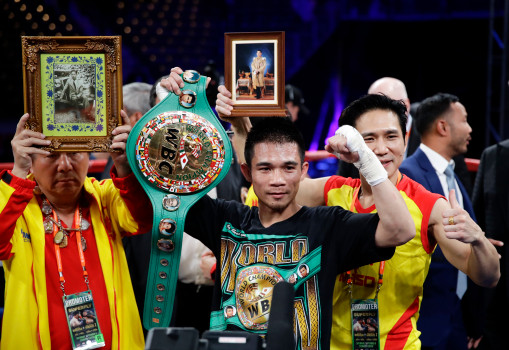 Srisaket Sor Rungvisai, of Thailand, poses for photos after knocking out Roman Gonzalez, of Nicaragua, during the fourth round of the WBC super flyweight championship boxing match Saturday, Sept. 9, 2017, in Carson, Calif. (AP Photo/Chris Carlson)
